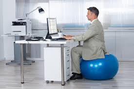 Stand Up Desk Exercises How To Use An Exercise Ball Chair Plus Standing Desk Tips