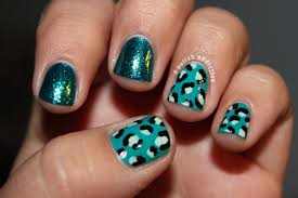 a polish addiction cheetah print and pure ice twisted accent nails
