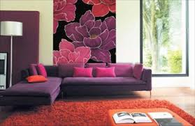 chic living room design with purple sofa and flowery walls