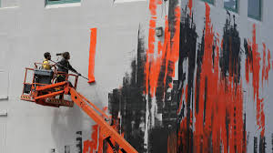 the new face of street art appears in warrnambool photos the artist matt adnate from melbourne working on an indigenous mural on the side of the south