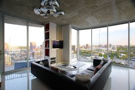 White Leather Sofa Living Room Ideas by Great Looking Living Room Design With Glass Wall And L Shape Black