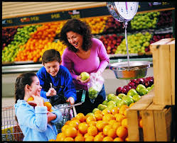 a with children shopping for fruit snap ed connection
