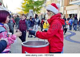 coca cola christmas promotion handing out free sample cans of