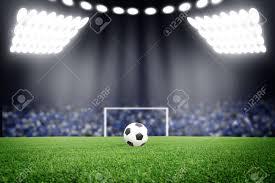 soccer ball on field in stadium at night stock photo picture and soccer ball on field in stadium at night stock photo 27335107