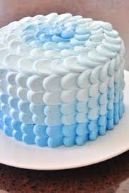a boys first birthday cake with blue ombre italian meringue
