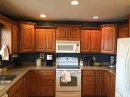 how to clean honey oak cabinets navy walls honey oak cabinets behr shipwreck home depot
