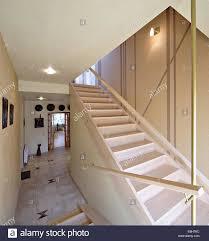 wooden staircase ladder in the modern luxury house vestibule