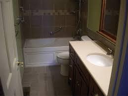 deep soaking tub with tiled walls and floor