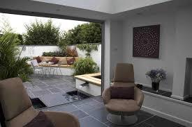 view of courtyard garden from sunroom designers cheltenham design