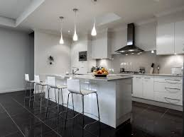 Kitchen Designer Melbourne Dark Stone Benchtops On White Cabinets In The Kitchen