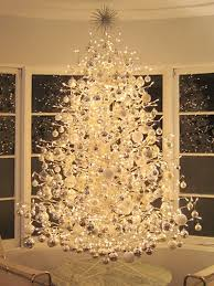 white tree with gold decorations happy holidays
