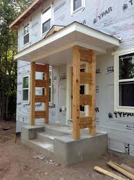 front porch posts in place a home in the woods
