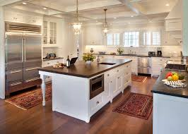 wood floors kitchen traditional with area rugs brass pendant
