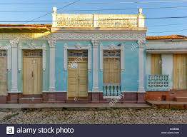 a quaint pastel blue painted house for sale in trinidad cuba