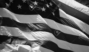 Black And White Us Flag A Close Up Of An American Flag Waving In The Wind Stock Photo