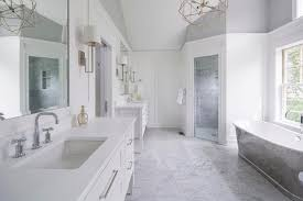white and gray master bathroom with cast iron tub and corner