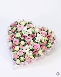 pastel pink and white funeral flowers