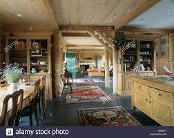oriental rugs on slate floor in open plan dining room with wooden