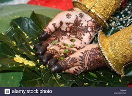 henna on hands of indonesian wedding bride stock photo royalty