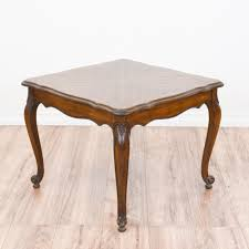 this french provincial end table is featured in a solid wood with