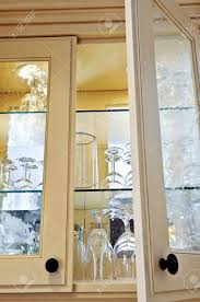 Kitchen Cabinet Close Up With Glass Shelves And Glasses Stock - Glass shelves for kitchen cabinets