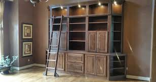 built in bookcase with ladder k c custom cabinets inc