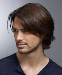 men u0027s hairstyle with ear long top hair and curls that curl up in