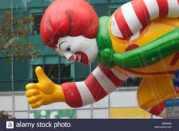 the ronald mcdonald helium filled balloon floats overhead during
