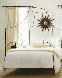bedroom wooden canopy bed with white ruffle top cover made of