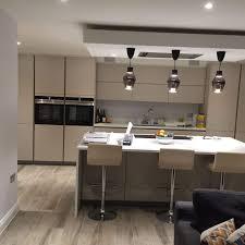 bathroom modern kitchen design with upholstered bar stools on