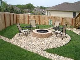 cream wall hardscape patios design backyard that has grey concrete