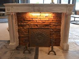 antique french limestone fireplace with columns