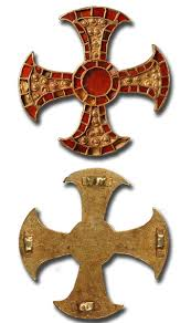 artifact pectoral in the shape of a cross archaeology magazine