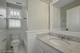 cottage full bathroom with wainscoting u0026 drop in bathtub in