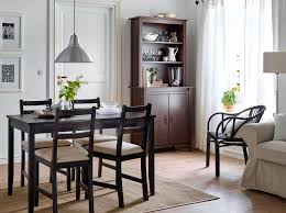 charming a dining room with a black brown dining table and chairs