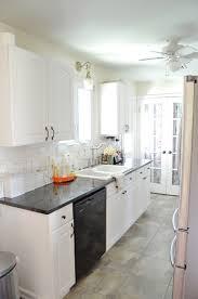 kitchen white galley kitchen with black appliances wallpaper