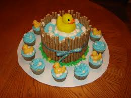 duck cake 8 2 layer cake surrounded by pirouettes with a rubber duck