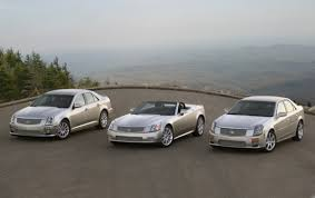 cadillac cts vs sts report cadillac s science program cost gm 4 3 billion gm