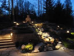 outdoor water features with lights i can imagine the trickle of water behind me and the crackling fire