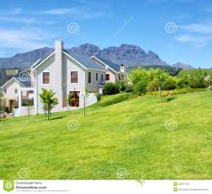 cape style house against blue misty mountains royalty free stock