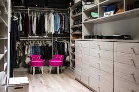 light taupe closet built ins with pink stools contemporary