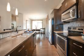 central kitchen with island stainless steel appliances dark