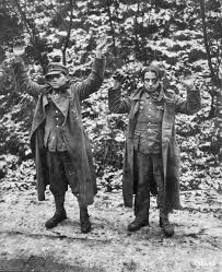 another pair of german youngsters in uniform surrender to us