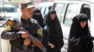 baghdad neighborhood imposes strict dress code on women