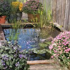 small backyard pond ideas with wood fence and flowers and trees