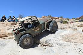 flat gray jeep vintage flat fender jeeps attack wipe out hill in moab rod