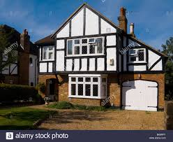 mock tudor black and white 1930 u0027s house with garage and a drive