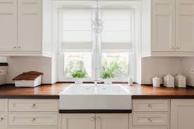 kitchen with white cabinets and wood countertops are wood countertops a idea butcher block pros cons 2021