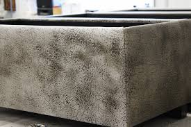 Cowhide Home Decor by Fireplace Best Home Furniture And Cowhide Ottoman With Nailhead