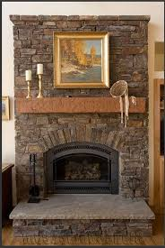 high stone fireplaces with small black box around painted wall